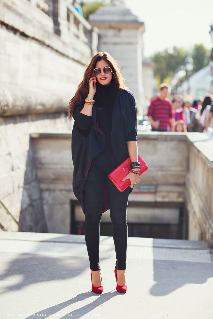 black outfit with red accents