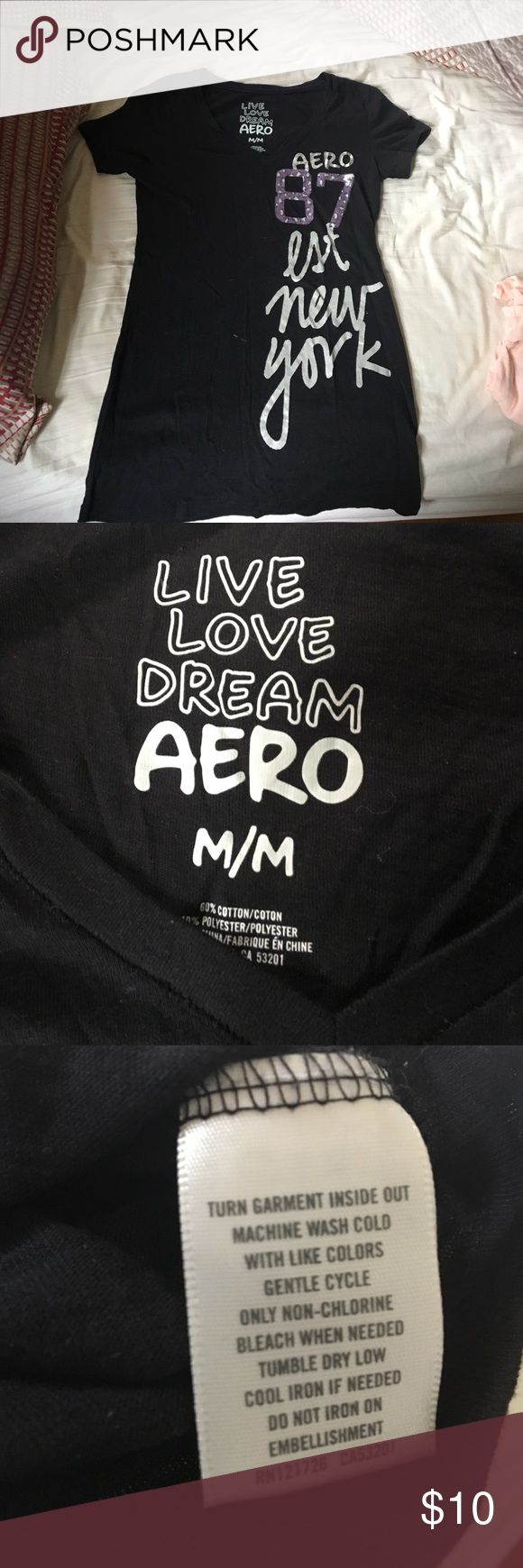 """Aeropostale black v neck T shirt Black v neck T shirt from Aeropostale , with the words """"Aero 87 Est New York"""" written on it, very comfortable fit, size medium will be washed and steamed before mailing! Is kind of baggy and long on me, and I am 5'0 Aeropostale Shirts & Tops Tees - Short Sleeve"""