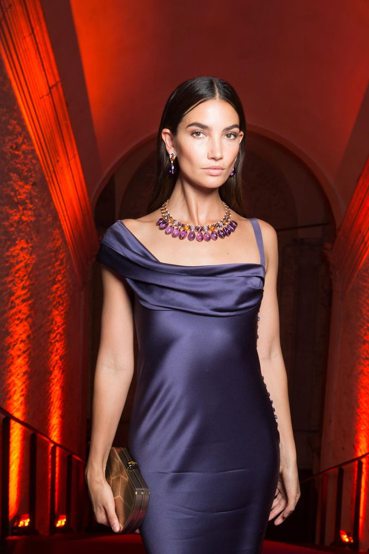 Lily Aldridge at Bulgari Festa in Venice, Italy, June 2017. Lily is wearing a satin sleek purple dress with Bulgari necklace and earrings. To see more Bulgari style, click here: http://www.thejewelleryeditor.com/brands/bulgari/