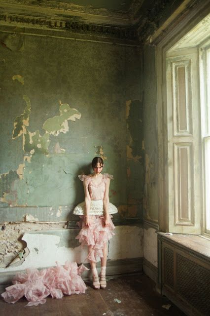 I love this! Its fashion and art; the woman is modelling the outfit and the interior is distressed and decayed, they both compliment each other
