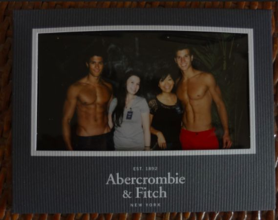 """""""Abercrombie & Fitch"""" using male and female models to take a photo at the entrance of the shop. The photos created huge popularity among millennials and led to long lines in front of the stores. The photos were used as status symbols and proof of visit in the exclusive locations, such as New York, Paris or London, where the stores were operating."""