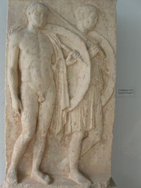 Two hoplites on a funerary stele, dated to 5th century BC. Piraeus Archaeological Museum, Greece