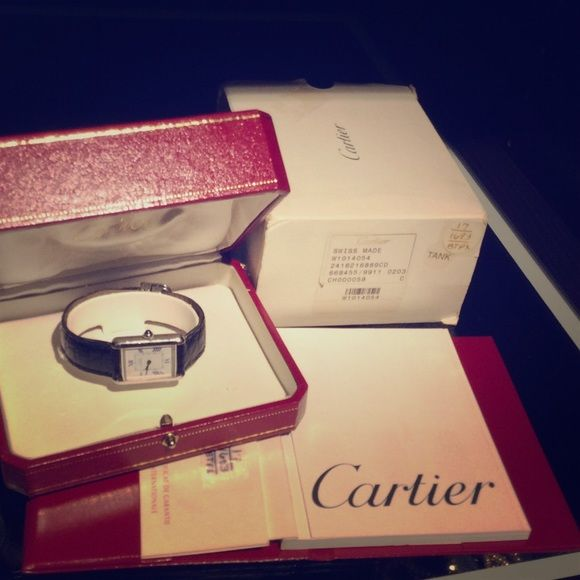 "Tank ""Must de Cartier"" AUTHENTIC Cartier Watch Tank Cartier Silver Tank with blue sapphire Cabochon W/ Box & Papers. OBO!               Don't bother to make a offers if your not valuing the item and what its worth specially ( condition) when this item don't loose value compared to other brands. Thanks Cartier Other"