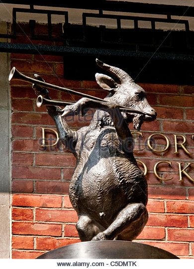 A pipes-playing goat statue performs to recorded music at the Delacorte Music Clock in Central Park Zoo, New York City. - Stock Image