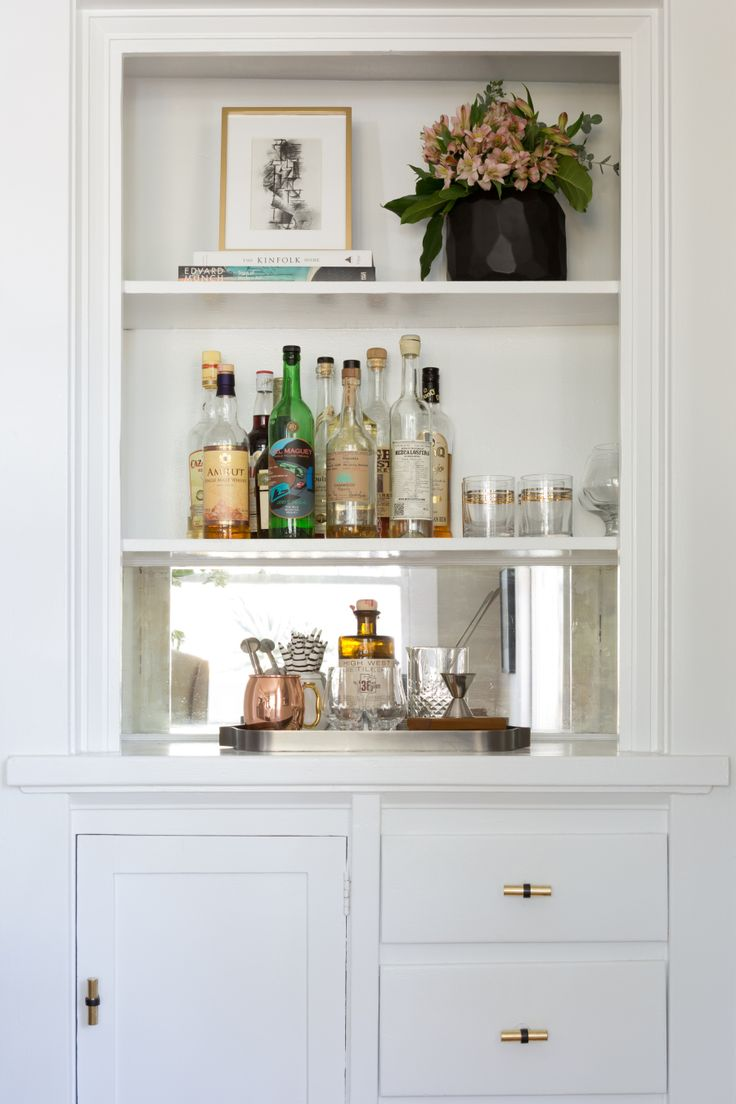 turning a built-in buffet into a bar station  Photography : Amy Bartlam Read More on SMP: http://www.stylemepretty.com/living/2016/09/21/crafting-a-dream-bungalow-in-venice-beach/