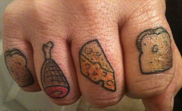 Meat, cheese, and bread knuckle tatts. | 27 Incredible Food Tattoos