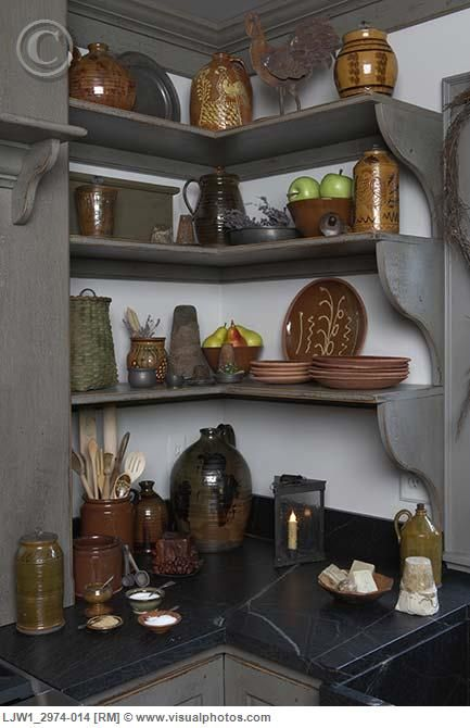 like the corner shelf idea but not this style.  Maybe in the corner of the window counters.