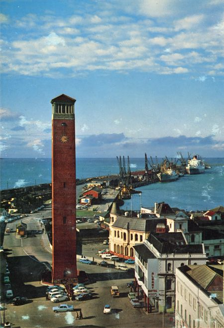 Colour photograph of campanile taken from a height. Harbour with shipping in background. To right, Albany Hotel and Customs House.  Submitted by Bryan WINTERMEYER Photographer: Unknown