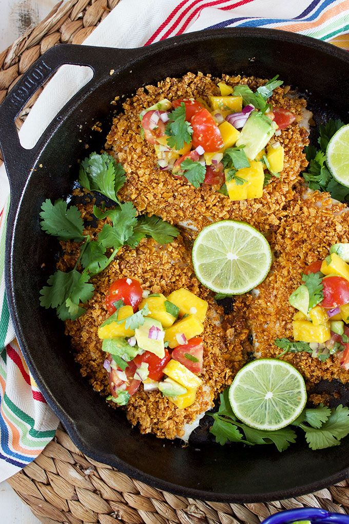 Ready in just 20 minutes, this easy Tortilla Crusted Tilapia recipe is topped with a simple and refreshing Avocado Mango Salsa! | @suburbansoapbox TheSuburbanSoapbox.com