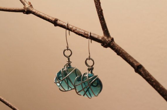 http://www.etsy.com/listing/166022731/clear-blue-entangled-glass-stone
