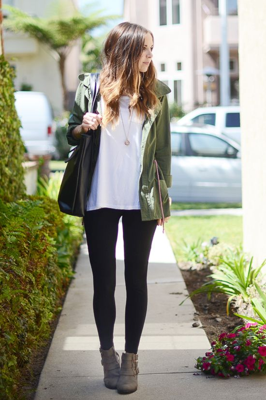 Tucking your pants into your ankle boots creates a long, lean leg line. Utility jacket, white shirt, dark leggings or jeggings, gray buckled ankle boots.