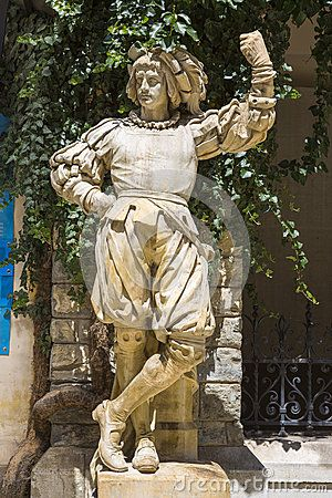 Medieval knight statue in the interior courtyard of Peles castle, Sinaia, Romania.