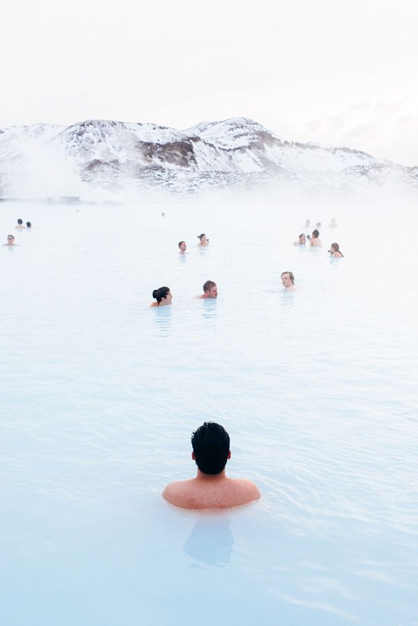 The Blue Lagoon hot springs in Iceland: a man-made lagoon supplied by water from a geothermal power plant. The water is milky blue and rich in silica and sulphur.