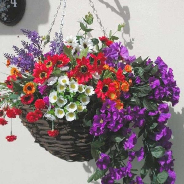 Large colourful artificial hanging basket with purple and ...