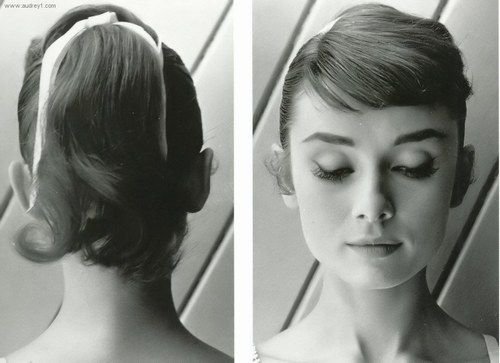 Audrey Hepburn with a long pony tail with short bangs. So pretty.