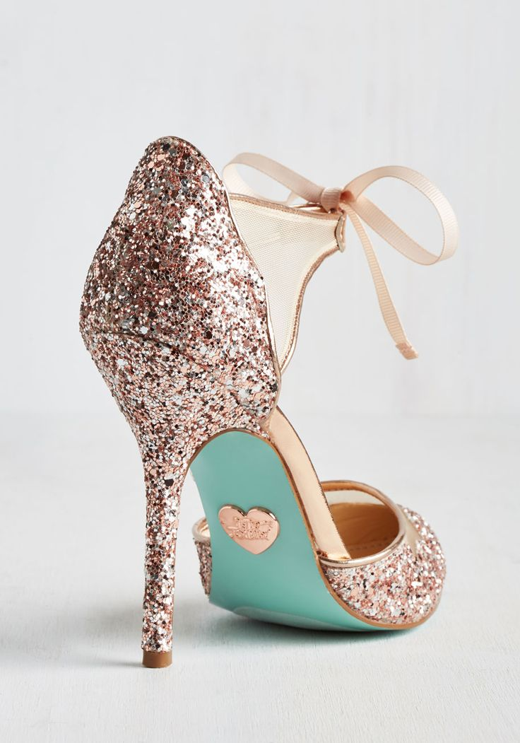 More power to the style maven who declares every day a day to sparkle! In these sassy stilettos by Blue by Betsey Johnson, said fashionista will flaunt cool beige mesh inlays, ribbon ties at the ankles, and a glittery burst of gold, silver, and soft pink hues whenever the spirit moves her. Brilliant!