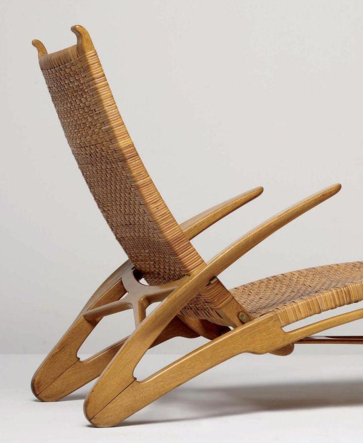 HANS J. WEGNER, The Dolphin Chair, c.1950. Material oak, cane and brass. Produced by Johannes Hansen, Denmark. / Phillips