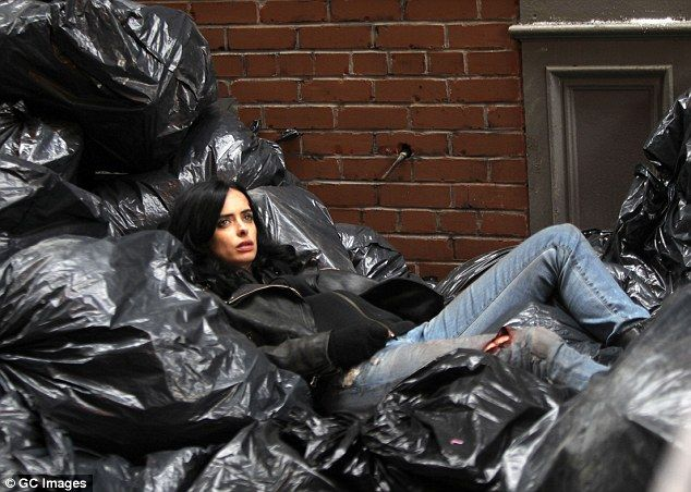 Less than glamorous: The actress was shot in a pile of rubbish with a less than glamorous appearance