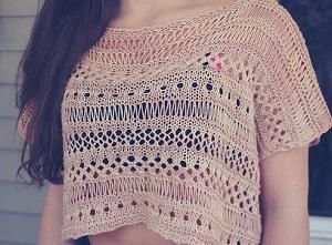 Beginner Boxy Lace Knit Top - The Beginner Boxy Lace Knit Top will be one of your favorite knitting ideas this summer. This gorgeous shirt pattern uses a variety of lace knitting techniques to show you how to make a shirt that is interesting and unique. Top patterns can be daunting, but this one is designed for beginners as it is two rectangles sewn together. This cute knitting pattern looks adorable over a tank top or camisole, or add a couple more sections to make a stunning swim suit…