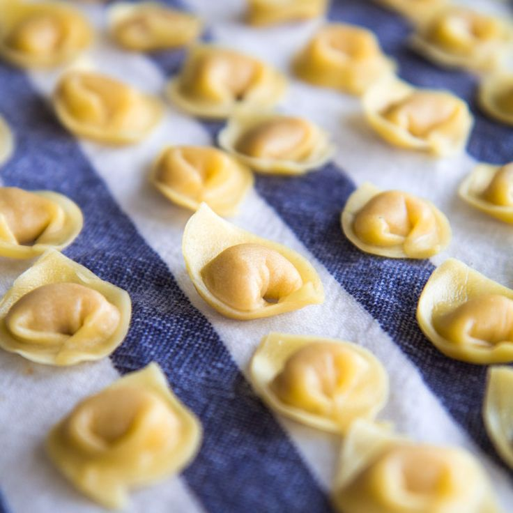 Homemade tortellini is one of the most important recipes of my hometown, Bologna! Here the history, the legend, and the traditional way to make them.