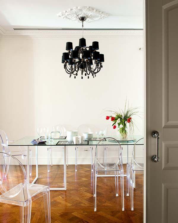 dramatic dinning- Lenoir chandeleir & starck´s louis ghost transparencies.designed by us @ nikohl cadeau interiors
