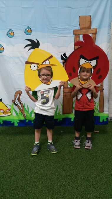 Angry Birds Photo Booth= shower curtain (use 20% coupon from BB&Beyond), props are painted foam core boards from Dollar Tree!