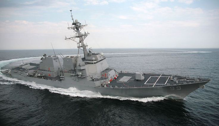 The Arleigh Burke class guided missile destroyer USS Farragut doing a high speed turn in the Strait of Hormuz.