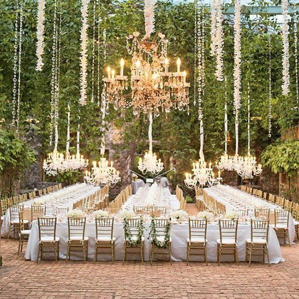 Having a garden wedding under the trees? Surprise your guests by hanging chandeliers lit by candles from sturdy branches.Photo Credit: Aaron Delesie