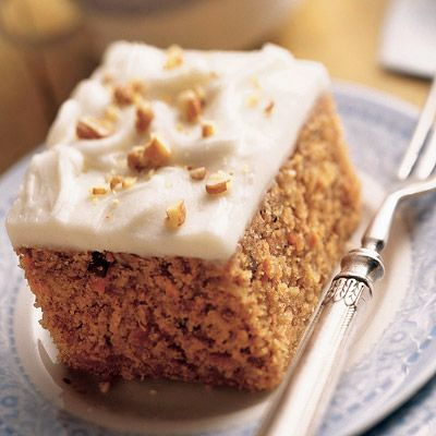 Homemade Carrot Cake with Cream Cheese Frosting: Classic carrot cake is filled with coconut and pecans and frosted with cream cheese frosting.