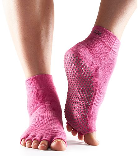Toesox Half-Toe with Grip Yoga Socks- Try the comfortable, hygienic alternative to bare feet, these yoga socks from Teosox  I think i need these.