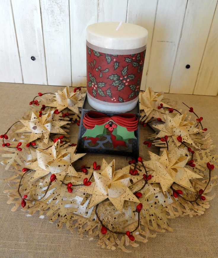 Centerpiece with paper candle holder and folded star