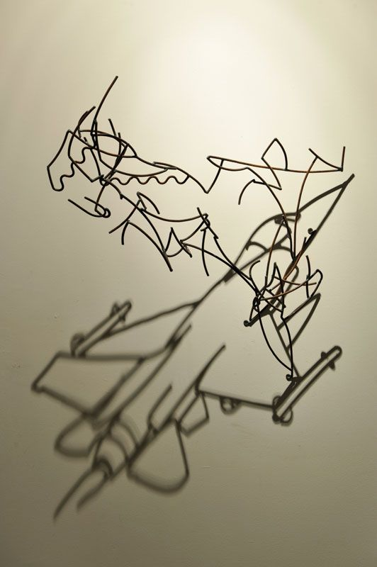 Larry Kagan wire sculpture casting shadow