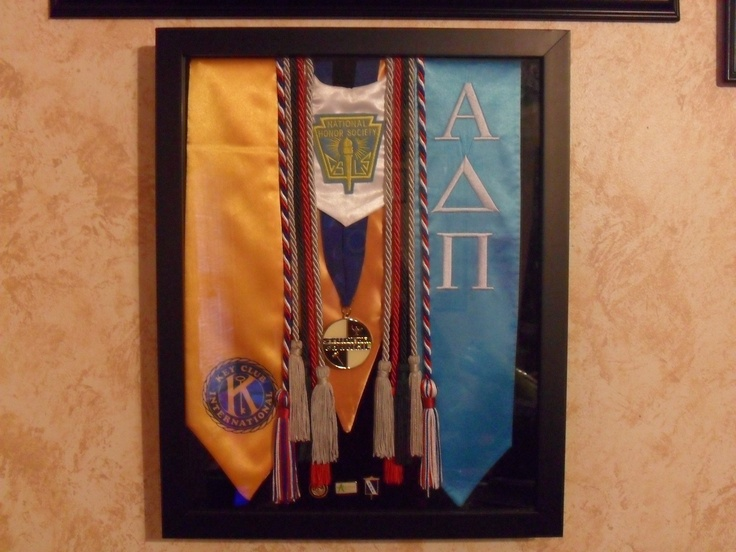 the start of my craftiness (: collect all those graduation tassels and cords and even pins in a shadow box!