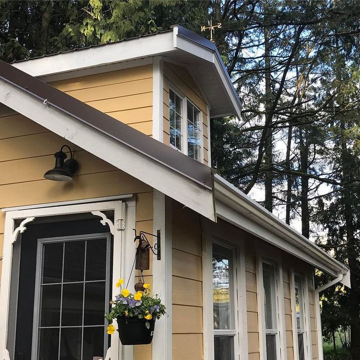 That point comes in every remodel where you can finally say you're almost there. It's hard to believe. How about that gold weathervane? It was black but you couldn't see it with all the trees so we painted it gold.      #farmlife #farm  #farmsofinstagram #farming #farmhousestyle #farmhouse #farmhouses #myfarm #farmyard #farmhouseofinstagram #yellowfarmhouse #weathervane #britishcolumbia #dormer #yellow #farmhousestyle #farmhousechic #farmhouseliving #exterior #curbappeal