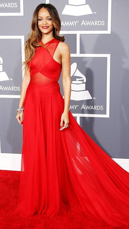 AZZEDINE ALAÏA, 2013 Rihanna played the ultimate lady in red at the 2013 Grammy Awards, where the Barbadian beauty looked unbelievably stunning and sophisticated in a candy-apple hued gown by Azzedine Alaïa.