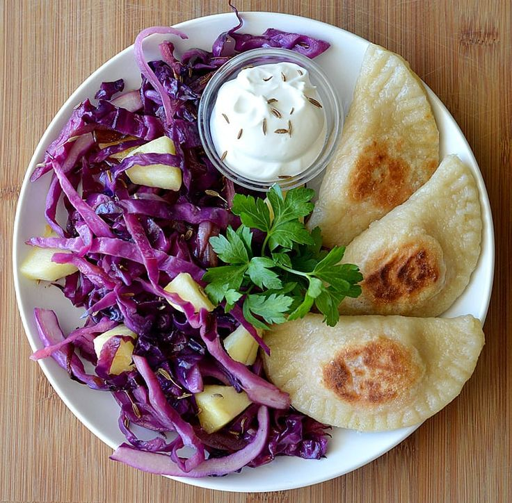 Sweet Potato Pierogi With Caramelized Onions, Sauteed Red Cabbage & Apples. Recipe by The Veg Life!