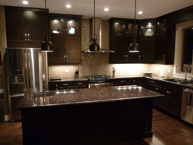 With dark cabinets - what you don't want – is a dark kitchen.  Today, with your dark cabinets and dark granite – there isn't much contrast.    White countertops, when used against dark cabinets, will provide that needed contrast and add an attractive pop to your kitchen.