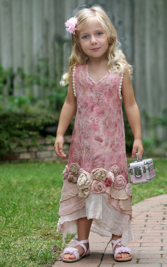 TUTORIAL for making a felted dress for a little girl with roses, lace and ruffles  This is a good place to start if you have some wet felting experience