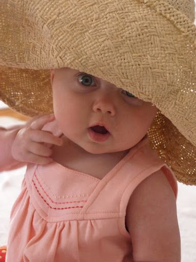What's not to love about a cute little girl wearing a hat that is much too big for her?