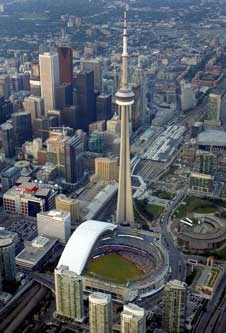 The Rogers Centre. Formally known as the Sky Dome, this building was innovative for its retractable dome. The dome helps define Toronto's skyline along with the CN Tower, which is visible from inside the stadium when the roof is open.
