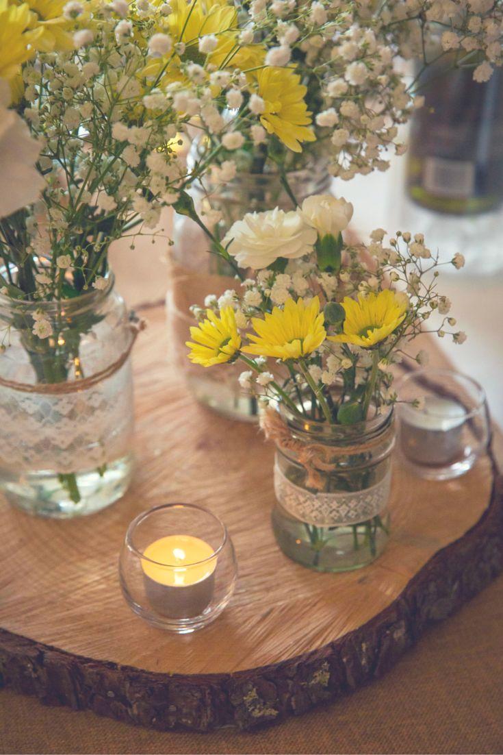 Nicole & Rick's sunny & fun yellow & grey winery wedding. Daisy & gypsophila, jars & lace on tree trunk cross section base.