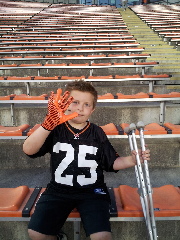 Crutches couldn't even stop him! Wearing his glove he was given after the game.