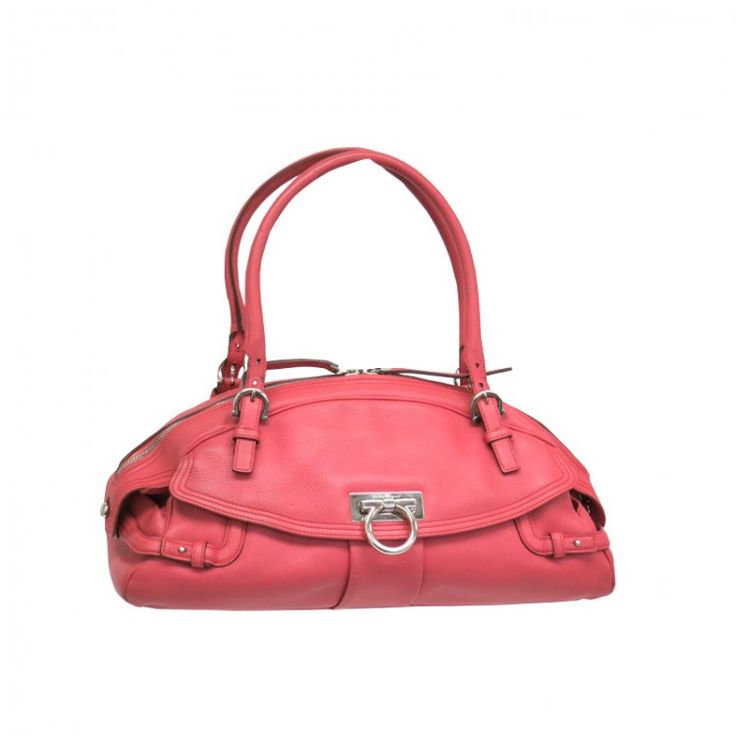 This authentic SALVATORE FERRAGAMO Hand Bag is made from pink leather. The interior opens to a pink textile. A perfect everyday bag with double shoulder straps the iconic Gancini buckle closure and a unique leather over-flap on the front. A classic design by FERRAGAMO that is a must have For more items like this visit https://www.swayy.com.au/