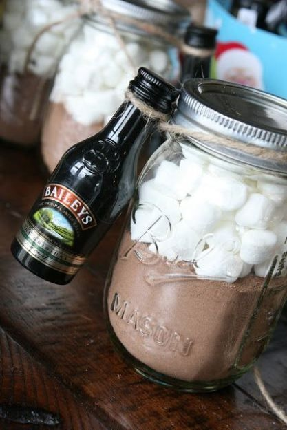 Hot Chocolate and Baileys Gift in a Jar: Simply fill a small mason jar with your choice of hot cocoa. You can use store bought packages and pour them in and fill the remaining space with marshmallows. Attach a mini bottle of Baileys Liquor and you have yourself a naughty but nice beverage. Make these by the dozen and hand out them to friends. Easy & affordable.