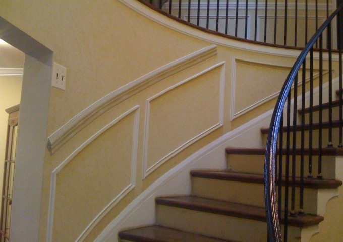 Chair rail and shadow boxes on curved staircase wall