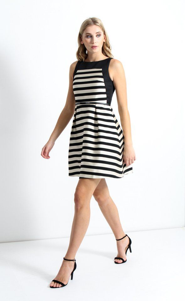 In a chic jacquard stripe, this piece is a new take on a classic style. The fitted bodice features a panelled border design, which lends a contemporary edge. This is contrasted against a full cut skirt, with tulle layered underneath to ensure the perfect amount of volume. Simply style with heels and delicate jewellery to create a feminine and sophisticated look for your next event.