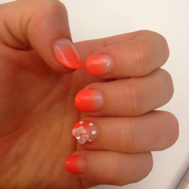 Gradient calgel manicure with 1 polkadot and ribbon design on the ring finger. So pretty!