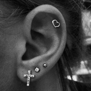 I had exactly this many piercings in one ear, until I joined the military. Never did get around to re-piercing my cartilage and third hole. This makes me want to again!