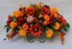 No.F012 Sun flower Fall Cemetery Arrangement . Headstone saddle, Grave, Tombstone arrangement, Cemetery flowers by AFlowerAndMore on Etsy https://www.etsy.com/listing/249162227/nof012-sun-flower-fall-cemetery
