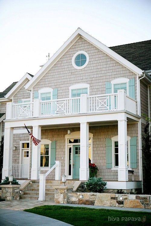 Love the light turquoise shutters for this beach house... and it looks cozy